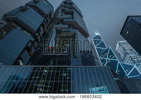 Skyscrapers from a low angle view at night in Hong KongChina.