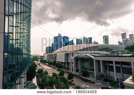 SINGAPORE - MARCH 22 2017: Cloudy day of The Shoppes at Marina Bay Sands. As one of Singapore's largest luxury shopping malls