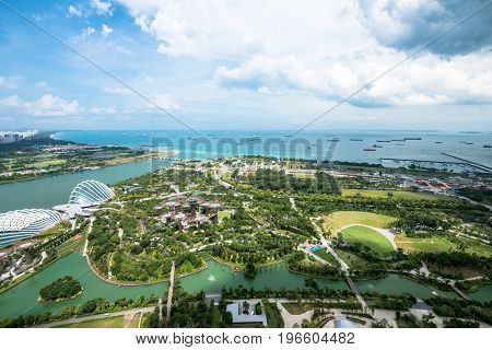 SINGAPORE - MARCH 22 2017: View from Marina Sands Hotel of Gardens by the Bay in Singapore. Sunny day and spectacular view.