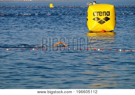 NICE - JULY 27 2017 : IRONMAN Nice 2017. 38 km swim in the Mediterranean Sea. Denis CHEVROT arriving first at beach.