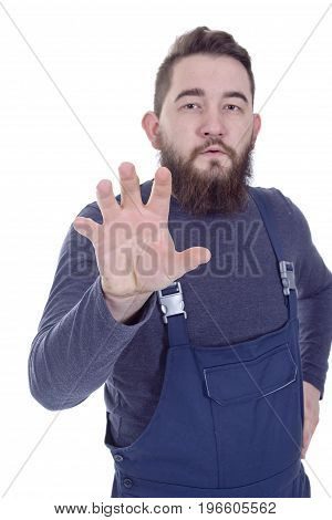 Young bearded man in overalls with a hand doing rotational movements