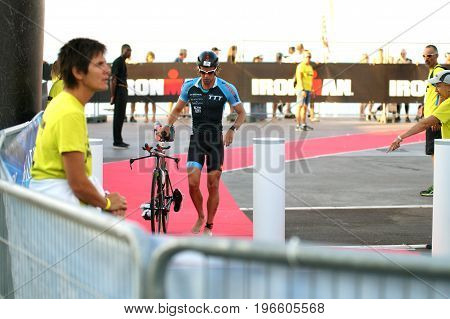 NICE - JULY 27 2017 : IRONMAN Nice 2017. Patrik ERICSSON finishing the swimming and starting for the 180 km bike tour