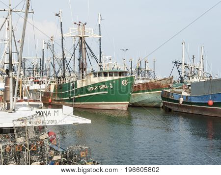New Bedford Massachusetts USA - July 11 2017: Fishing vessels docked along New Bedford waterfront