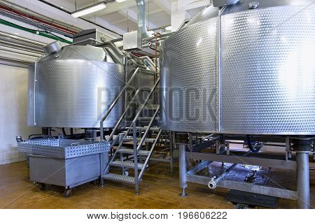 Industrial dairy production. Storage steel tanks on the milk factory.