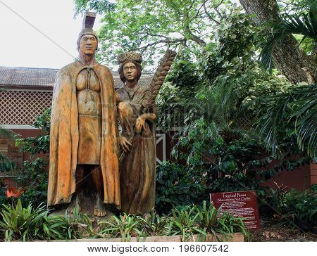 Honolulu, Hawaii, USA - May 29, 2016: Harry and Mary Lake Statue at Tropical Farms Macadamia Nut Outlet