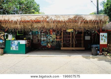 Honolulu, Hawaii, USA - May 29, 2016: Tropical Farms Macadamia Nut Farm Coconut Hut