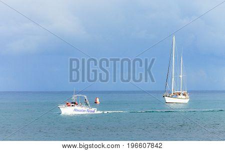 Honolulu, Hawaii, USA - May 30, 2016: Tourists enjoying boating activities just off Magic Island, Ala Moana Beach, Honolulu