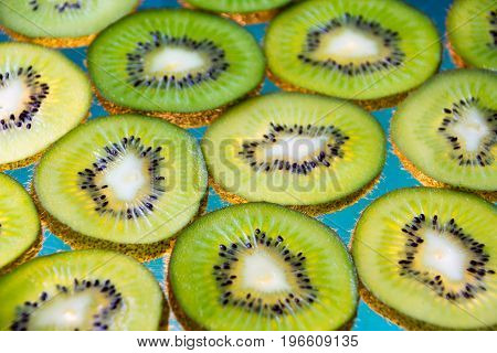 Green Kiwi Fruit Slices On Lighted Glass