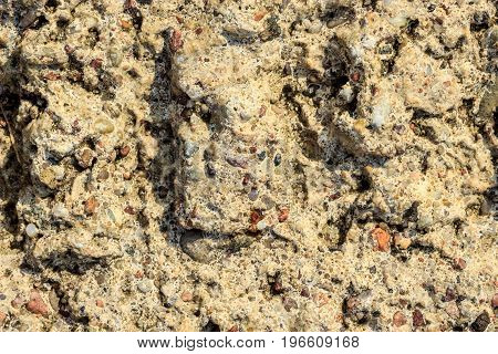 Brown grunge wall stone background or texture solid nature rock