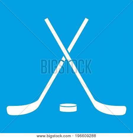 Crossed hockey sticks and puck icon white isolated on blue background vector illustration