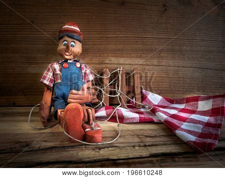 Traditional puppets made of wood on wood table