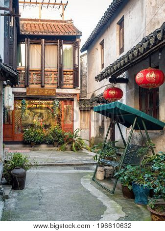Suzhou, China - Nov 5, 2016: A quiet alleyway leading to a restaurant at the historic Zhouzhuang Water Town.