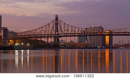 Ed Koch Queensboro Bridge over East River at sunrise in New York City USA. A view on scenic sunrise over the bridge from Roosevelt Island.