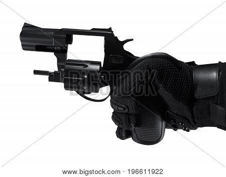 Hand in tactical black gloves holding opened barrel revolver black gun profile view.