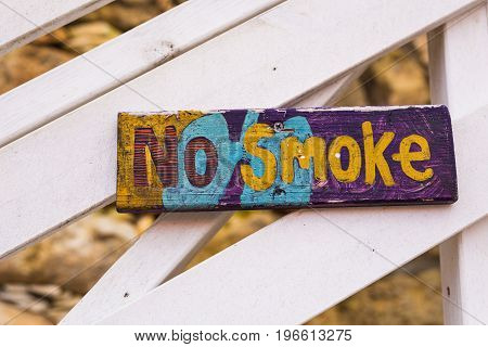 Old wooden no smoking sign. Sign board