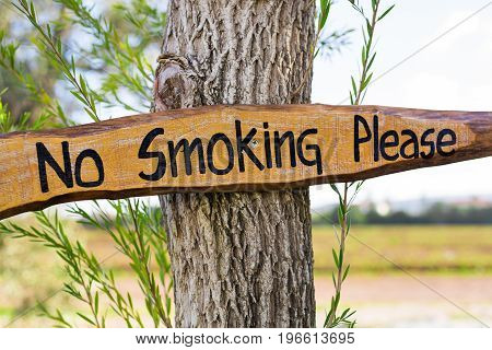 No smoking sign vintage style on wooden board