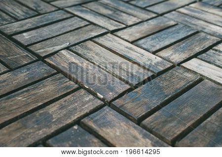 Closeup on old floor. Wethered wooden background. Selective focus side view