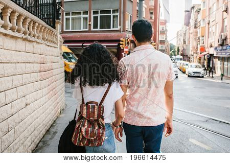 Young couple walking along the street in Istanbul. Urban life style. Routine. Life in Turkey.