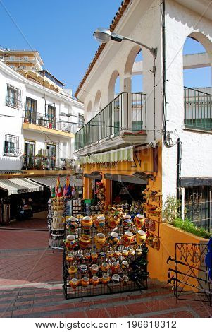 TORREMOLINOS, SPAIN - SEPTEMBER 3, 2008 - Elevated view of an old town shopping street with a ceramics shop in the foreground Torremolinos Malaga Province Andalusia Spain Western Europe, September 3, 2008.