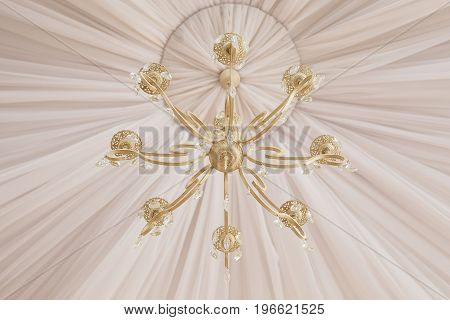 Close-up of a beautiful white crystal chandelier.