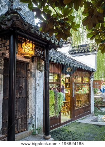 Suzhou, China - Nov 5, 2016: A tea house in a quiet corner at the historic Zhouzhuang Water Town. The building is in classical Chinese style.