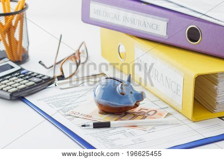 Clean Insurance Form, Folders, Pen, Piggy Bank And Calculator