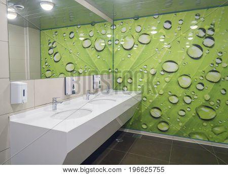 Volgograd Russian Federation - February 17 2017: Public empty restroom with washstands mirror