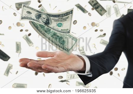 Businessman with rainy dollar banknotes isolated over white background. Concept of success, career and big income