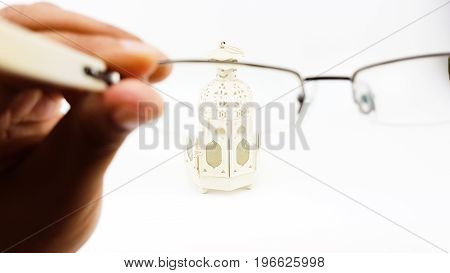 Blurry Eye In Out Of Focus Eye Glasses's Lens In Man Hand