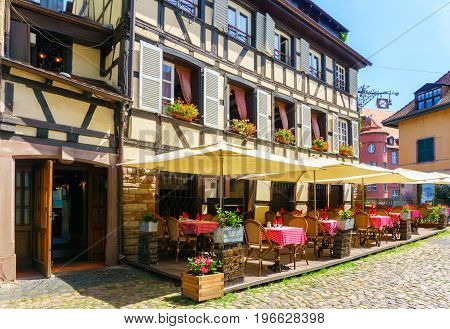Cafes and restaurant in Petite-France in Strasbourg Traditional colorful houses in La Petite France Strasbourg Alsace France