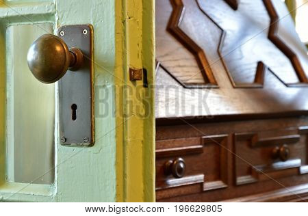 Wooden door knobs and keyholes at the entrance of the room