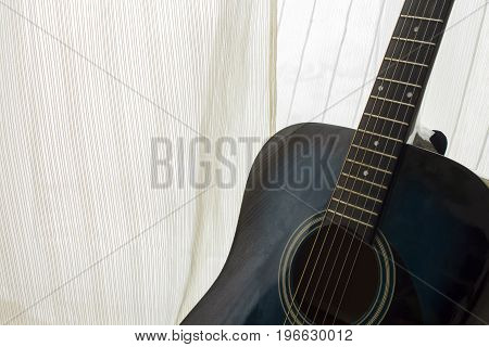 detail of classic guitar with shallow depth of field.