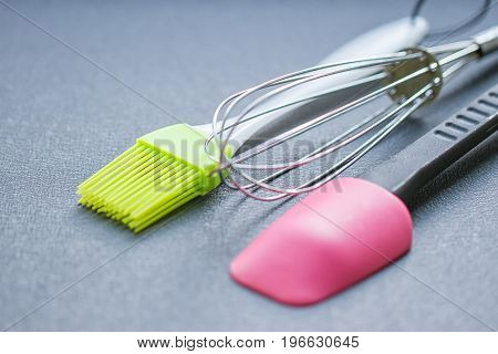 Background of kitchen utensils : Culinary brush whisk spatula