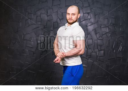 Personal Trainer Strong Guy Standing. Copyspace And Flexing Muscles. Muscular Athletic Man Posing.