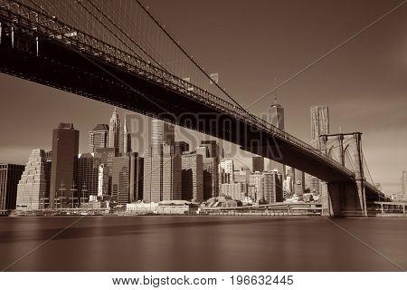 Below Brooklyn Bridge with downtown Manhattan skyline in New York City