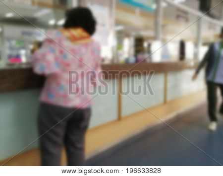 Blur abstract background reception hall customer counter service in hospital Thailand