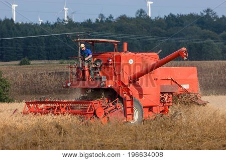 WEST POMERANIAN / POLAND: Harvester in the field during the harvest