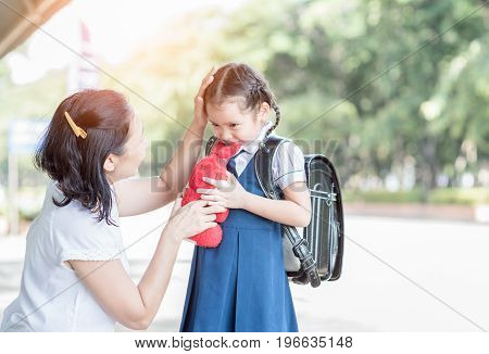 Mother Standing At School Holding Hands And Teaching