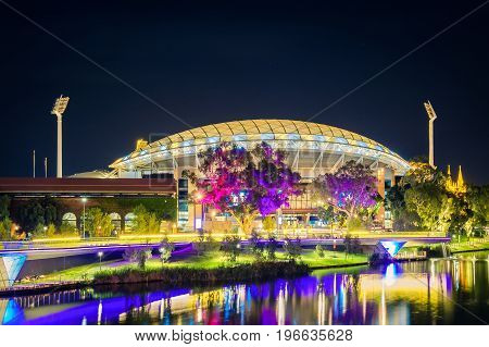 Adelaide Australia - April 16 2017: Adelaide Oval with footbridge across Torrens river illuminated at night time
