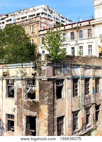 Old Abandoned High-rise Building In The City Centre On A Summer Day. Social Inequality.