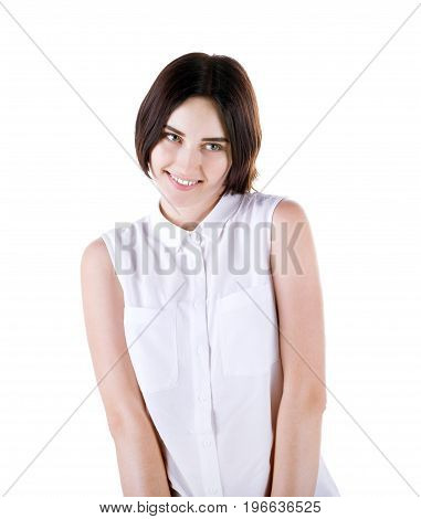 An adorable lady with a charming smile, isolated on a white background. A beautiful and smiling brunette girl with short and dark brown haircut. A romantic and playful young woman in white blouse.
