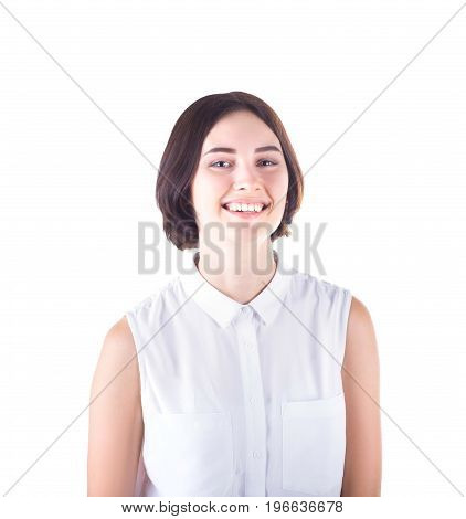 A smiling beautiful lady in elegant blouse, isolated on a white background. An attractive brunette girl looks happy. A professional and cheerful business woman. A female with a good mood.