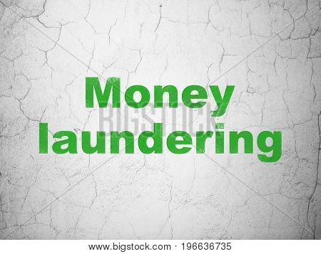 Currency concept: Green Money Laundering on textured concrete wall background