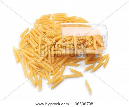A transparent and inverted glass with uncooked pasta. Raw and fresh flour products. Bright yellow dry Penne pasta, isolated on a white background. Italian rigate pasta.
