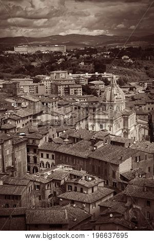 Medieval town Siena rooftop view with historic buildings in Italy
