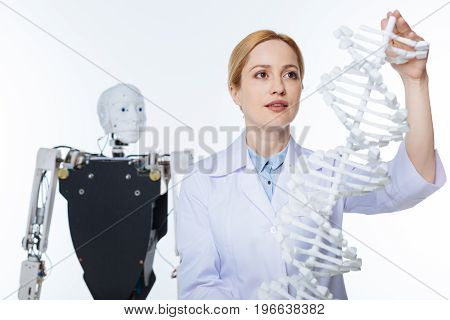 Innovative approach. Unconventional open minded stunning scientist studying how genetics and robotics influencing each other while working in progressive lab
