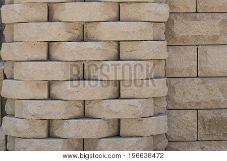 Decorative beige masonry in the style of a sandric