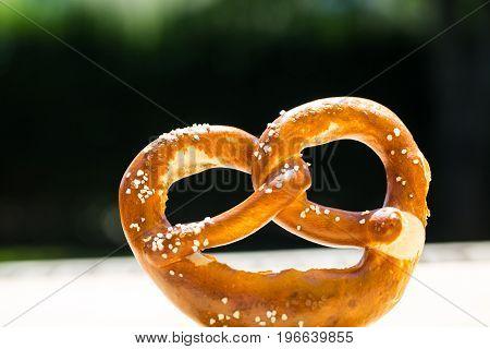 Bread alone with green background, pretzel, munich