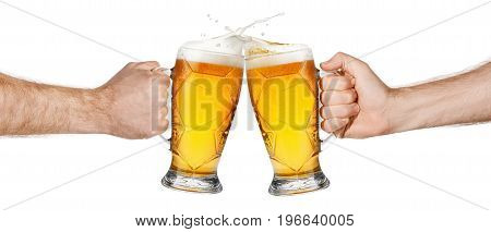 two mugs of beer toasting creating splash isolated on white background. Male hands with beer mugs making toast. Beer up