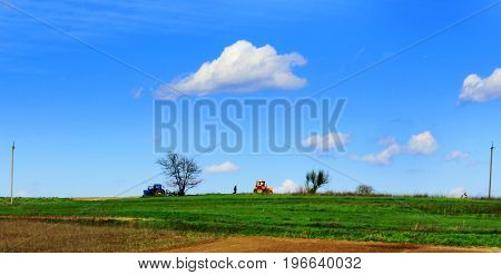 Tractors in the field tractor driver clouds
